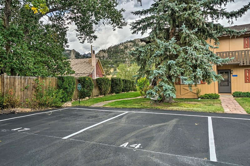 Enjoy the convenience of a reserved parking spot at this Rocky Mountain abode.