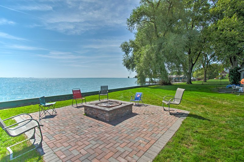 Gather around the fire pit right next to Lake St. Clair!