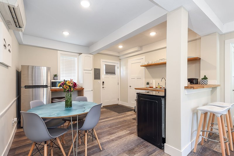 This contemporary space is brand new, cozy, well stocked and close to everything!