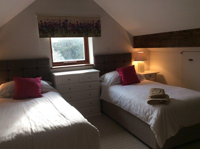Twin galerij slaapkamer, kan een super kingsize zijn.
