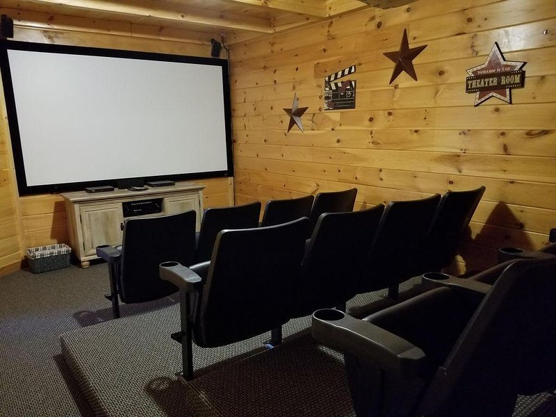 Theater with projection screen and surround sound