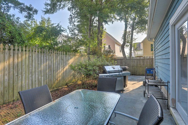 Soak up the sun in the privacy of this fenced-in patio.