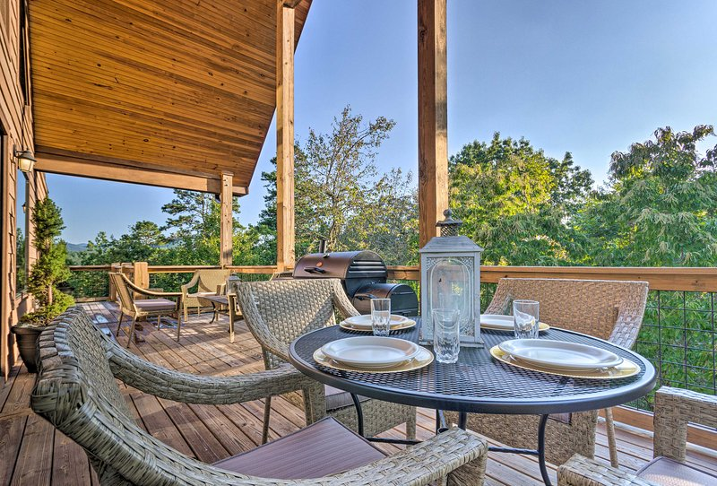 The vacation rental cabin features a deck with gorgeous views.