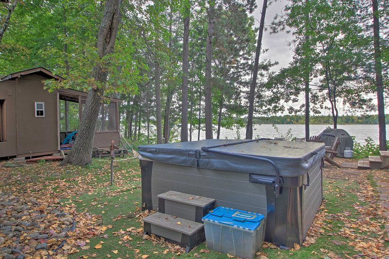 Situated on Loon Lake, the home includes a sauna and hot tub!