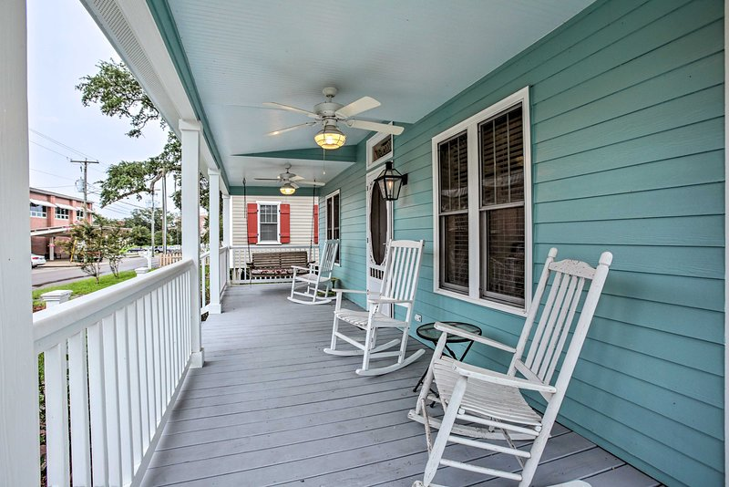 Sip a refreshing beverage from the porch of this Bay St Louis vacation rental.
