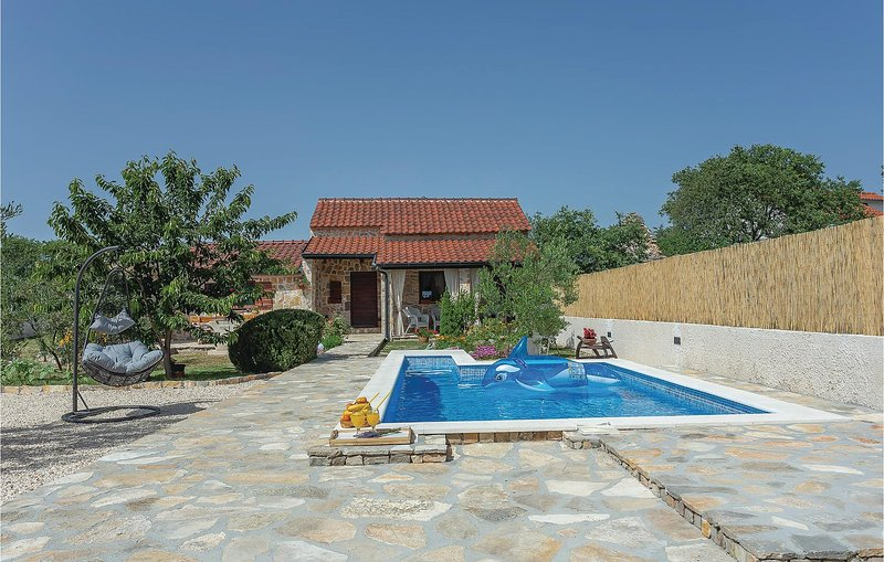 Beautiful home in Konjevrate w/ WiFi, 1 Bedrooms and Outdoor swimming pool (CDJ6, holiday rental in Pakovo Selo