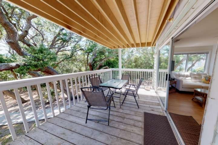 Beautiful view of a live oak tree right from the large back deck, enough room for your entire crew