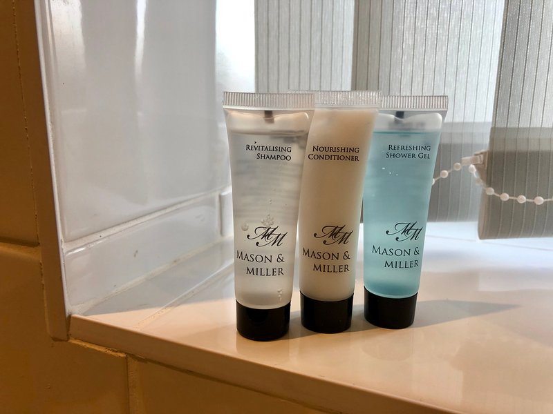 Complimentary miniature shampoo, conditioner and shower gel.