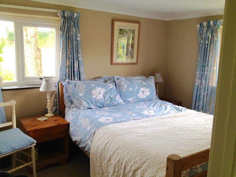 Double bedroom overlooking the garden.