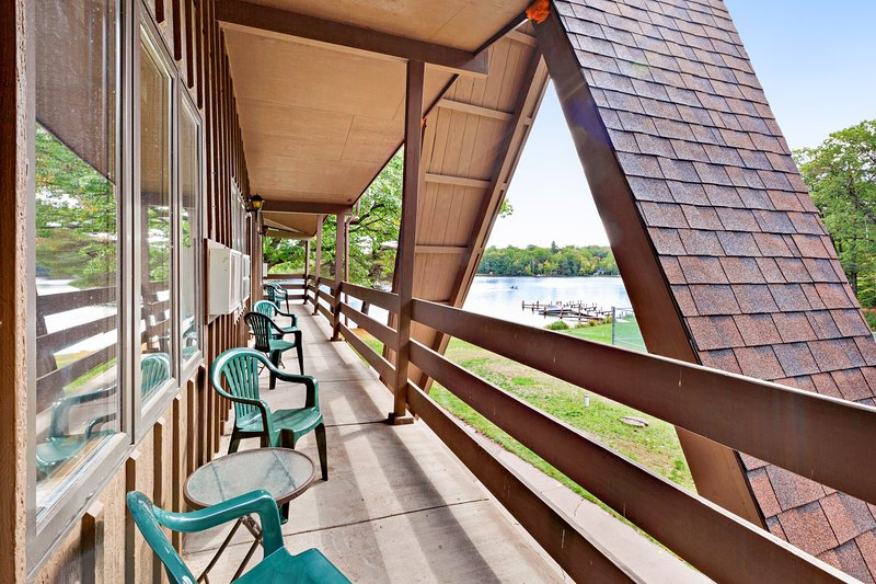 Lake view room at historic lakefront motel w/ shared beach & dock - dogs OK!, holiday rental in Eagle River
