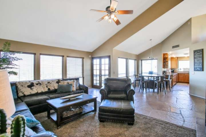 Family room, dining area and kitchen and door to the deck & BBQ grill