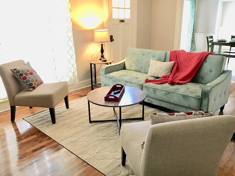 The living room is a comfortable size, with seating for 6. The couch folds down into a futon.