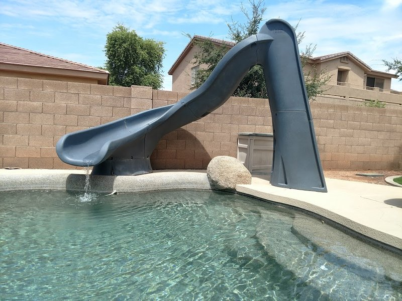 Swimming pool with Twister water-slide, seasonally heated at no extra charge!