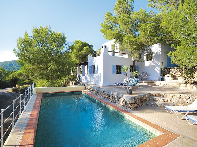 Holiday in Ibiza, nestled between green with private pool, holiday rental in Es Codolar