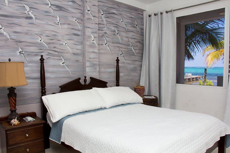 Room with a Queen Size bed overlooking the Caribbean Sea and Barrier Reef.
