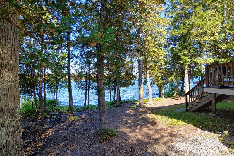 Cozy lakefront home w/ a firepit, outdoor shower, & private beach!, holiday rental in Dexter