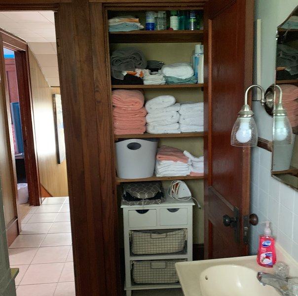 fully stocked linens in bathroom