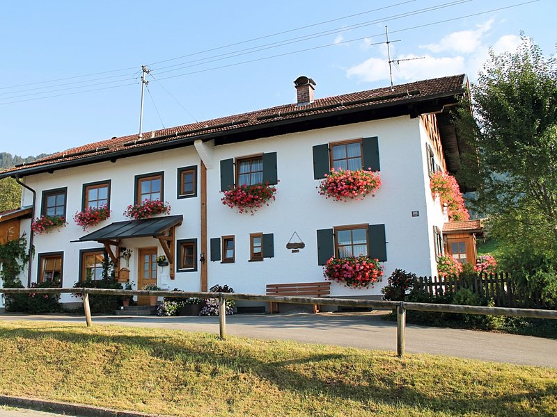 Holiday home in the Allgäu featuring a tiled stove and a private terrace with m, holiday rental in Dietringen