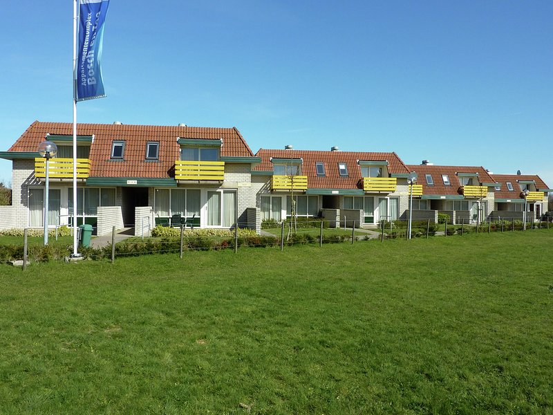 Well-kept apartment, not far from the beach and sea on Texel, location de vacances à Den Burg