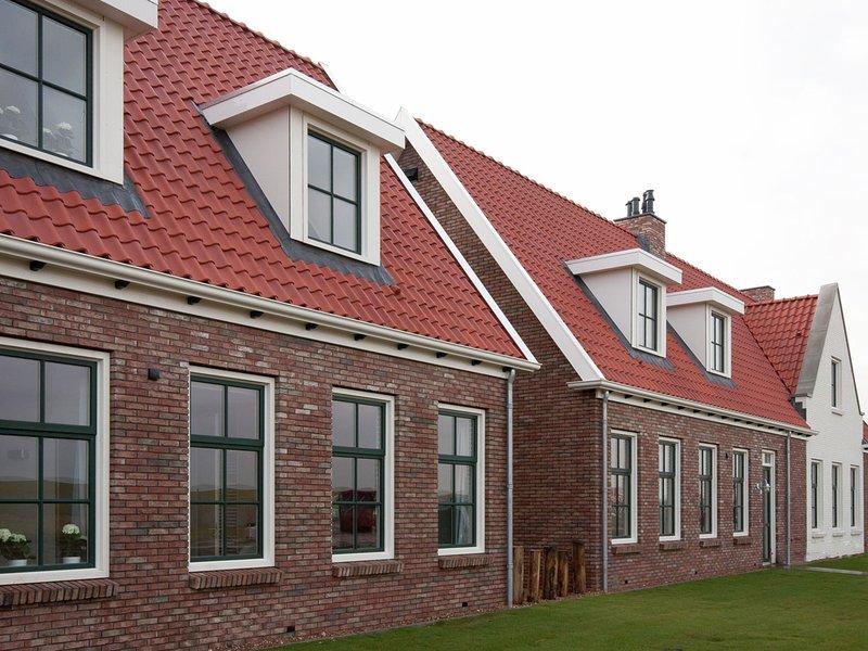 Luxury, stylish cottage with indoor pool, whirlpool, sauna and sun shower, location de vacances à Colijnsplaat