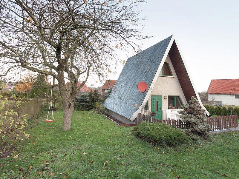 Cosy A-frame house in the Harz with stove, private terrace and garden, aluguéis de temporada em Neuwerk