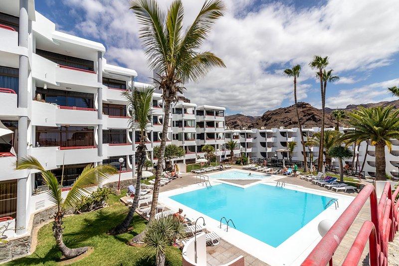 Flatguest Cardenal + Vista Mar + Piscinas + Playa, aluguéis de temporada em Playa de Cura