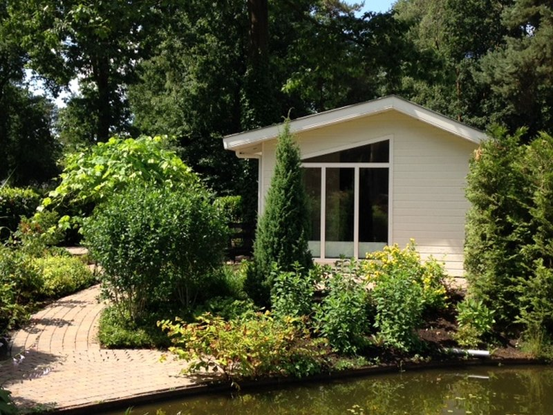 Comfortable chalet with dishwasher, within De Veluwe, casa vacanza a Lunteren