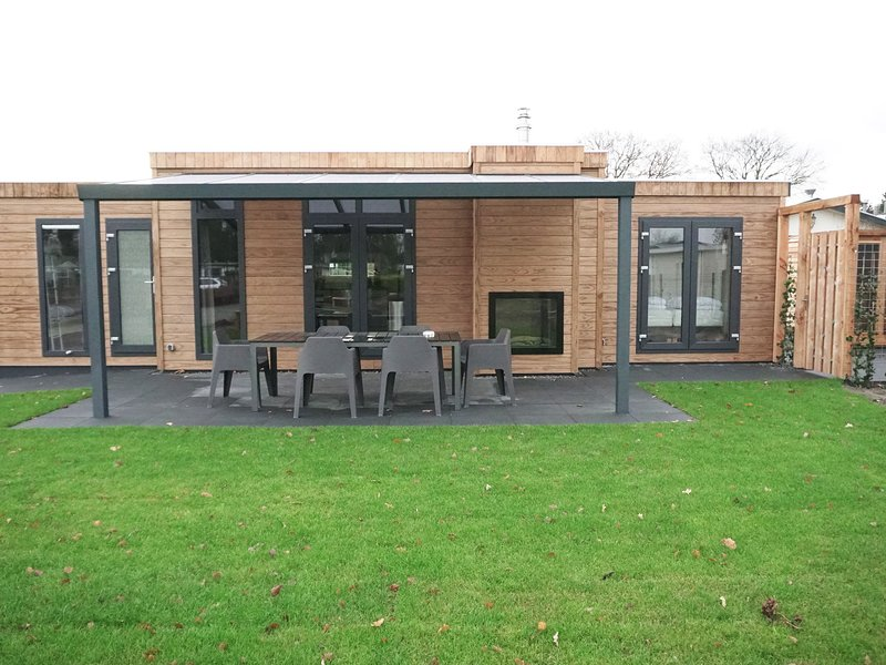 Modern chalet with a decorative fireplace near the Veluwe, holiday rental in Kootwijk