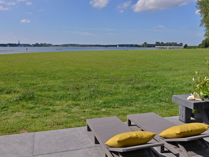 Modern and tasteful house ith private jetty on Lake Veere, vacation rental in Veere
