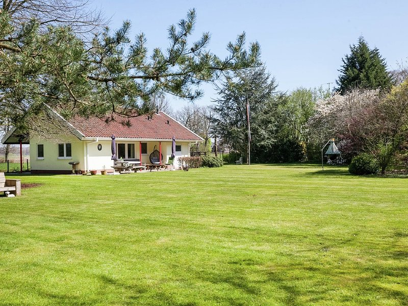 A detached home with playground equipment, large enclosed garden and covered ter, holiday rental in Heeten