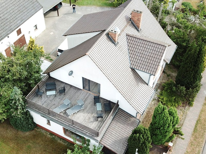 Large holiday home with roof terrace and big garden with lounge area and grill, holiday rental in Usedom