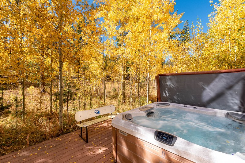 Enjoy a private hot tub wrapped in nature
