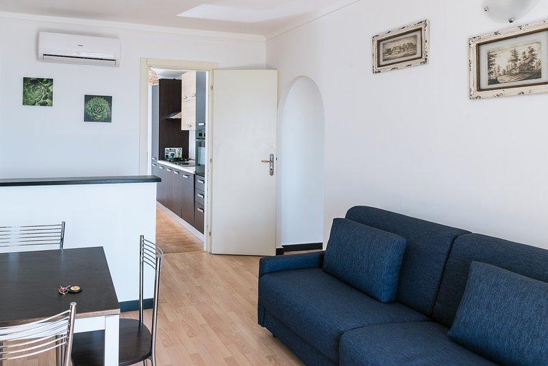 Soggiorno con divano letto doppio Appartamento Ulivi 3