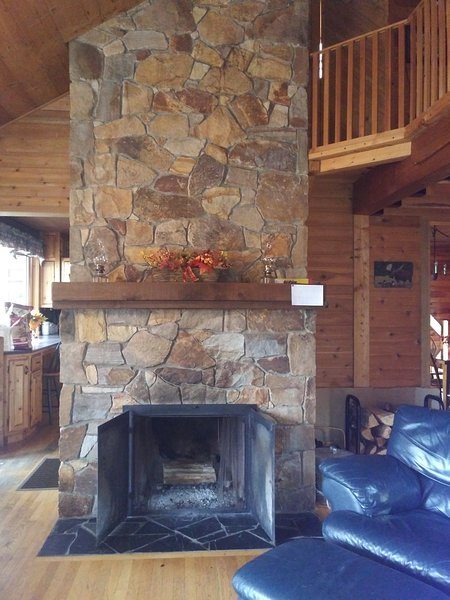 Cozy up in front of a fire in our floor to ceiling fieldstone fireplace.