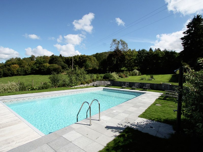 Modern villa with shared pool nearby Saint-Hubert, holiday rental in Resteigne