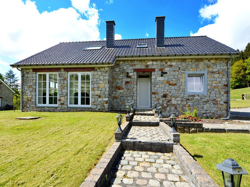 Detached natural stone house with sunny garden and terrace, modern interior, holiday rental in Manhay