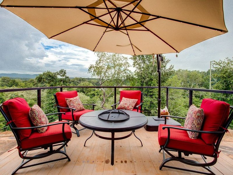 Porch views with fire pit. The Bohemian House at Upstream Way.