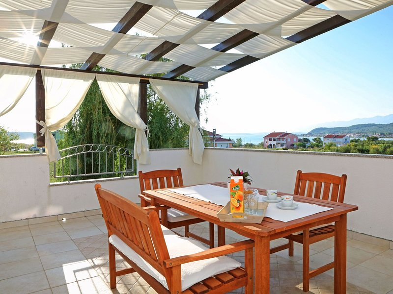 Modern  ground floor apartment with private terrace only 200m from the sea, holiday rental in Ljubac
