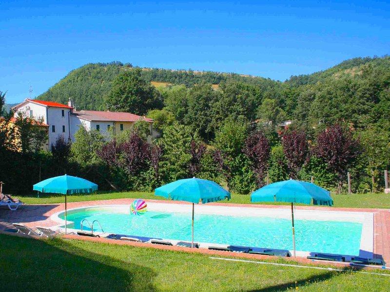 Cheerful apartment with communal pool in a quiet area, Ferienwohnung in Borgo Cerreto