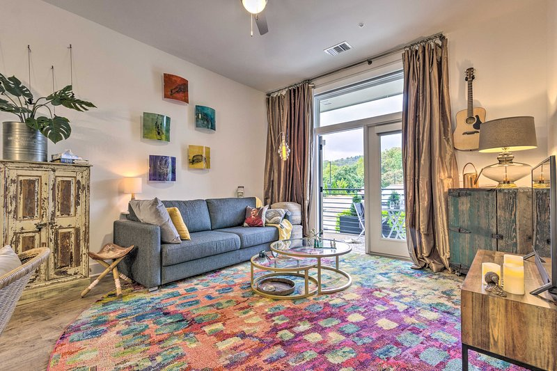Lounge inside this vacation rental after an adventurous day in Asheville!