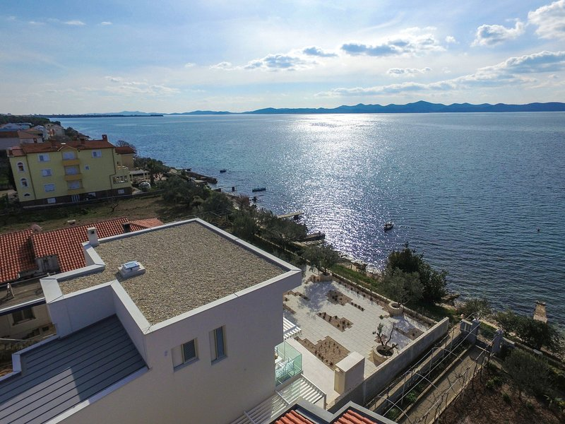 Newly constructed beachfront luxury villa with amazing sea view, large terrace, vacation rental in Kozino