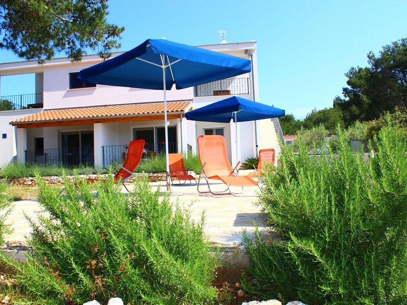 Modern holiday home with terrace,100 m distant from the sea !, holiday rental in Dugi Island