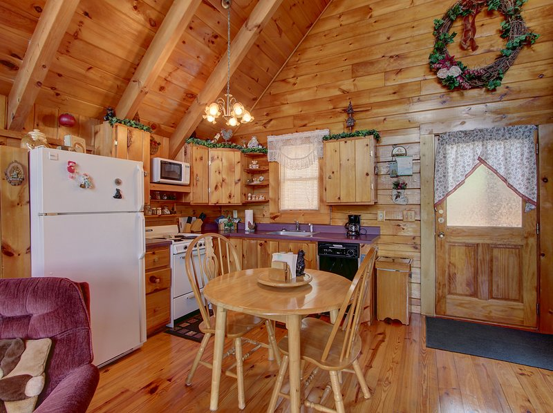 Hardwood,Flooring,Refrigerator,Furniture,Chair