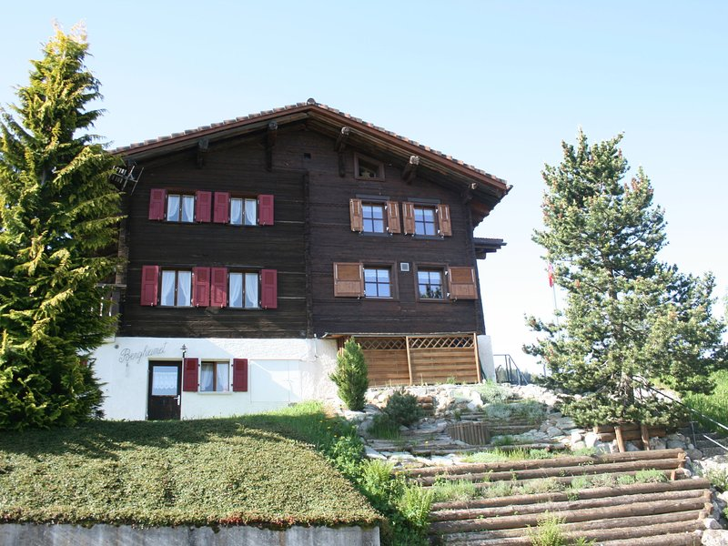 Spacious Holiday Home with Private Terrace in Obersaxen, holiday rental in Surcuolm