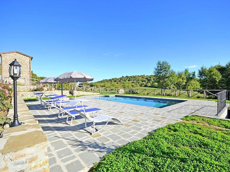 Villa with private pool near Cortona in the calm countryside and hilly landscape, location de vacances à Col di Morro