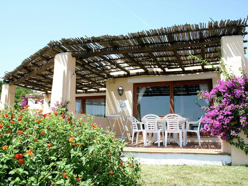Holiday home in Sardinia with pool and terrace with country views, vacation rental in Punta de su Torrione