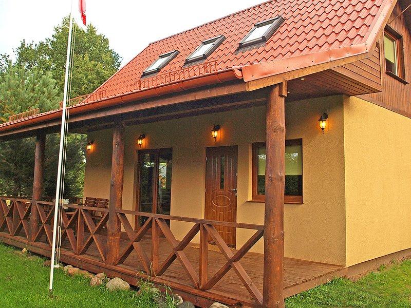 Cozy Holiday Home In Kopalino With Garden, alquiler de vacaciones en Leba