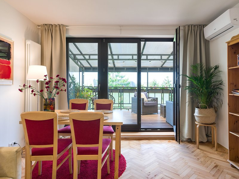 City apartment with superb location and riverside terrace adjacent, vacation rental in Stroza