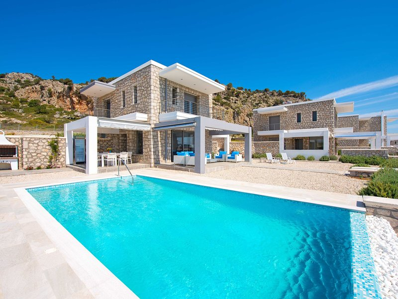 Beautiful new luxury villa near the coast, nice pool, beautiful sea view, Rhodes, vacation rental in Afandou