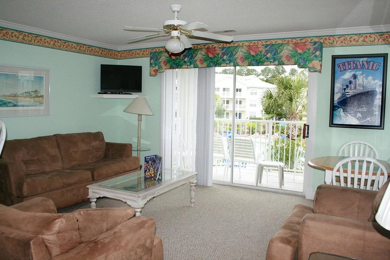 Furniture,Couch,Ceiling Fan,Indoors,Room